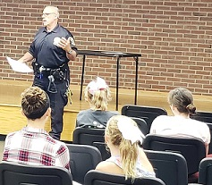 photo of Tweens and teens learning about safety from Police Officer Richard Pedone at the Babysitting Workshop on September 18, 2018