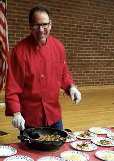 photo of Chef Robert Dell'Amore with skillet